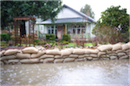 Sandbags piled in front of a door